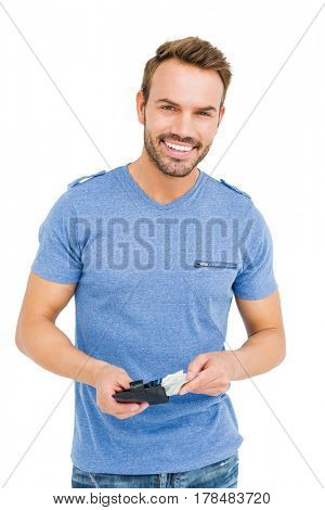 Young man removing money from his wallet on white background