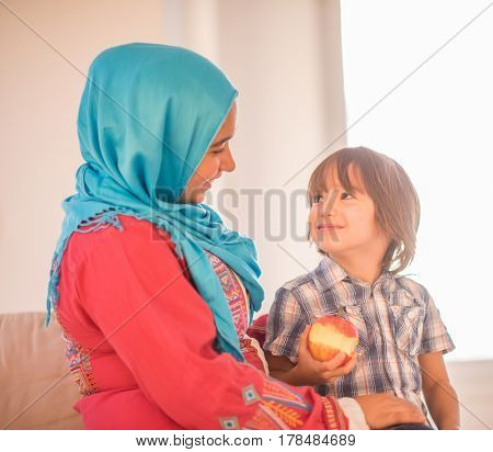 Young woman with little kid at home