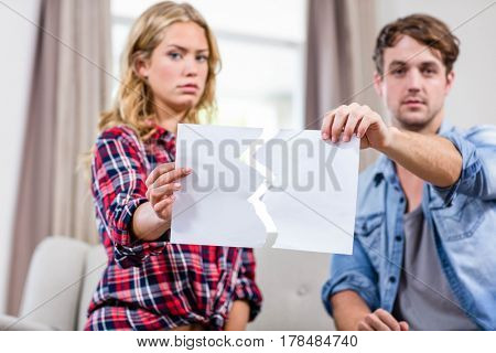 Couple having an argument on the sofa