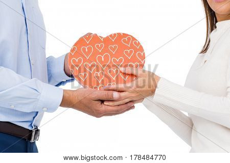 Cute couple holding box with hearts on white background
