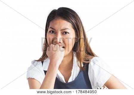 Businesswoman biting her fist on white background