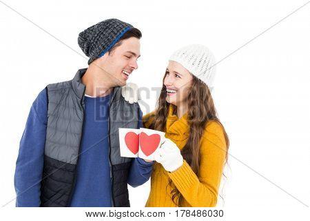 Smiling couple holding mug on white background