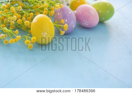 Hand Painted Multicolored Decorated Easter Eggs On Blue Wood