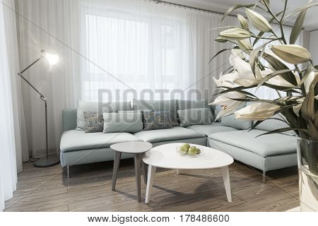 Modern interior of a small private apartment sitting room sofa and tables