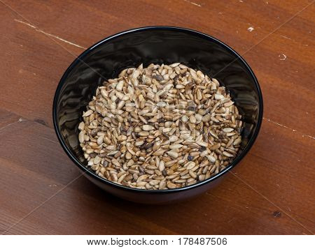 Peeled sunflower seeds in black bowl