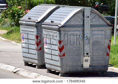 Two large metal containers for disposal of garbage