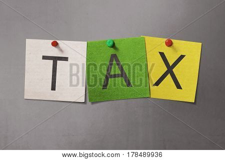 Colorful Sticky Note With Tax Text With Red Pin Thumbtack