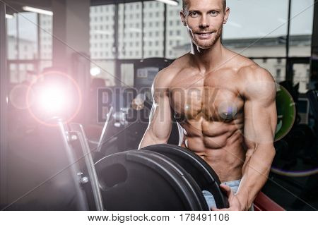 Caucasian Sexy Fitness Male Model Execute Exercise With Barbell