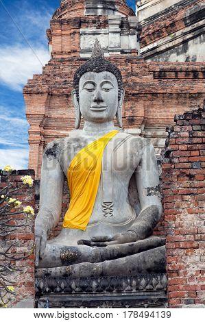 Ancient Buddha statue at Wat Yai Chaimongkol in Ayutthaya, Thailand