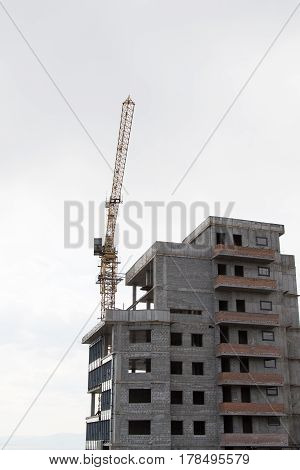 Vladivostok Primorsky kray Russia - March 21th 2017: Vladivostok the new under construction house with the building crane.