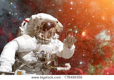 Astronaut in outer space. Galaxy and stars on the background. Elements of this image furnished by NASA.