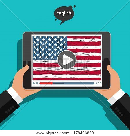 Concept of learning languages. Study American English. Hand drawn American flag on the tablet screen. Film in English.