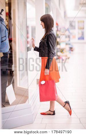Beautiful woman window shopping in mall
