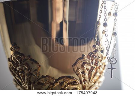 Catholic religion theme.  . Gold chalice - close up of its details.