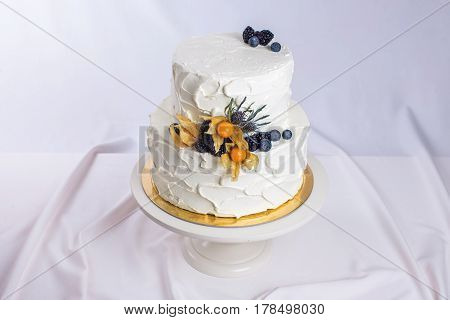 Two-tiered White Cream Cake Decorated With Berries