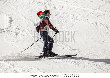People Skiing Dressed With Traditional Bulgarian Clothes.