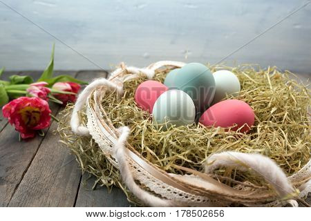 Easter decoration with colorful eggs in country house style