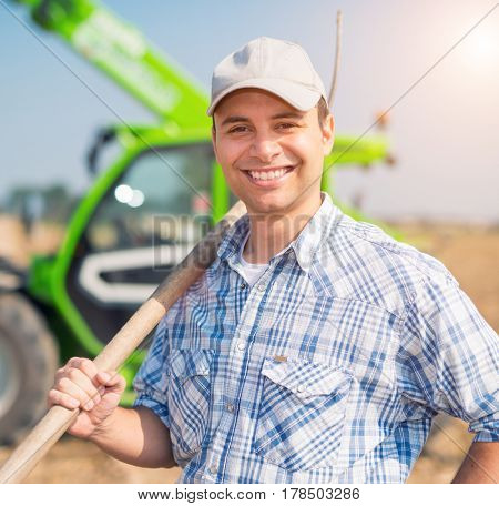 Smiling farmer at work, lens flare effect