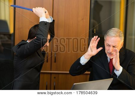 Angry businessman attacking his boss