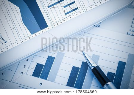 Closeup of business documents, blue toned image