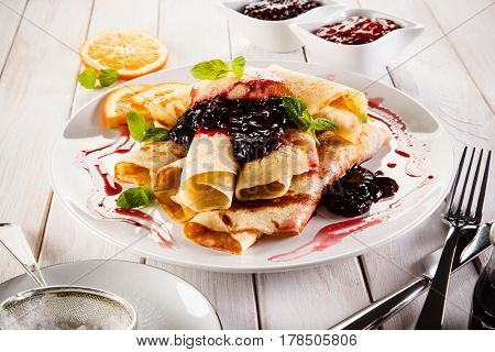 Crepes with oranges and blueberry jam