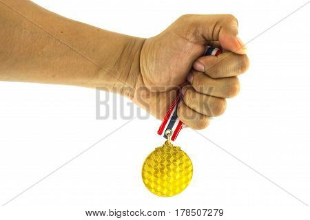 Closeup the human hand hold the gold medal on the white background