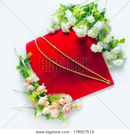 Gold Necklace 96.5 Percent Thai Gold Grade With Flowers Putting On On Red Flannel Cloth Background I