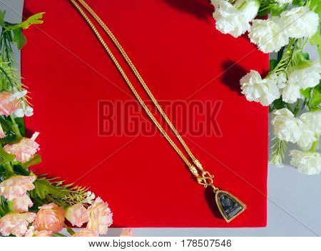 Gold Necklace 96.5 Percent Thai Gold Grade With Buddha And Flowers Putting On On Red Flannel Cloth B