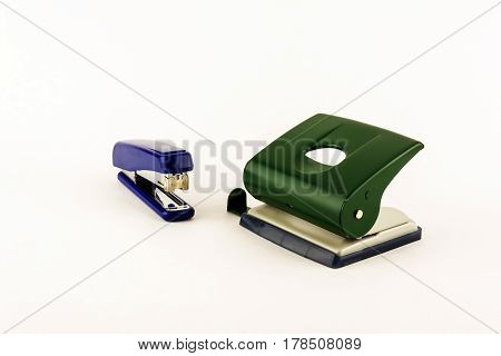 Stationery - stapler and punch on a light background