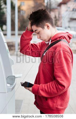 Boy noticed that he lost his debit card
