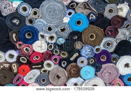 Large amount of different colored sewing thread. Close view