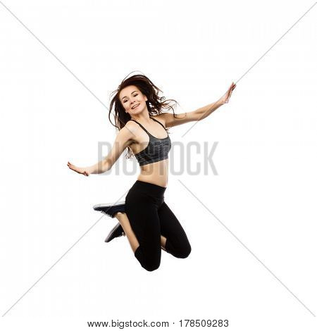 Young woman jumping isolated on white