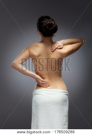 Woman massaging back pain