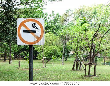 Label no smoking metal sign in the parkBangkok Thailand