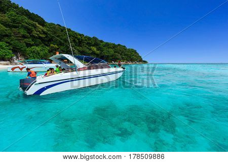PHANG-NGA, THAILAND - APRIL 15, 2013 : Beautiful tropical Andaman sea with tourist boat and blue sky at Tachai island, located near Similan island, Phang-nga, Thailand