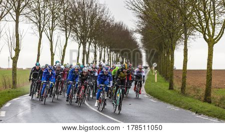 Angerville France - March 6 2017: The peloton riding on a wet road during the second stage of Paris-Nice on 6 March 2017.