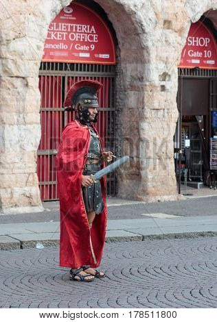 Verona Italy September 27 2015 : One man dressed in the form of Roman legionaries stands at the Piazza Bra square near the Arena in Verona Italy