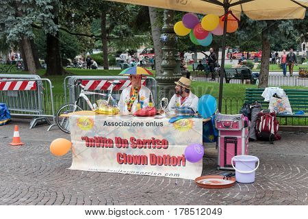 Verona Italy September 27 2015 : Two men dressed as a clown doctor are invited to look at their shows and smile at Piazza Bra square in Verona.