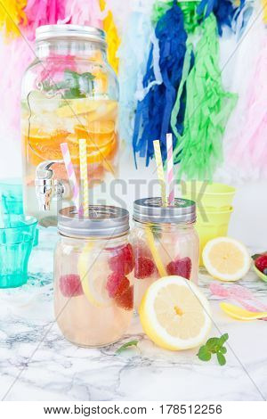 Fresh homemade lemonade with lemon and raspberries