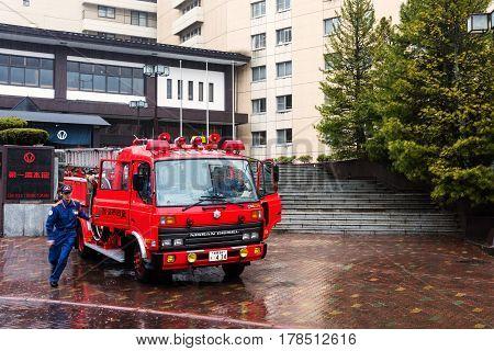 NOBORIBETSU HOKKAIDO JAPAN - APRIL 23 2016: Unidentified fireman officer practice to extinguish a fire in town.
