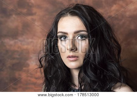 Portrait image of a beautiful young female looking at the camera. Taken with copy space.