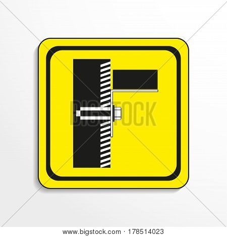Symbol. The anchor in the wall. Vector icon. Black-and-white object on a yellow background.