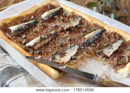 French sardines onion pie with capers pissaladiere
