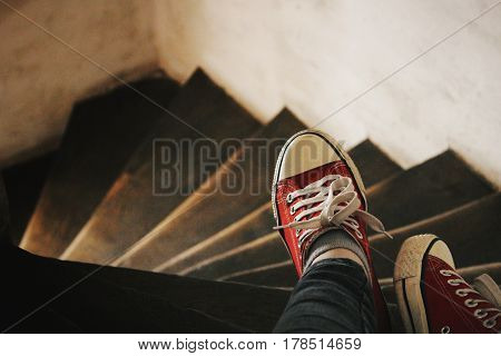 Wooden stairs and red sneakers in the tower.