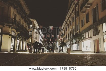 The illuminated street of Viale Stazione in Bellinzona at night. Canton Ticino, Switzerland.