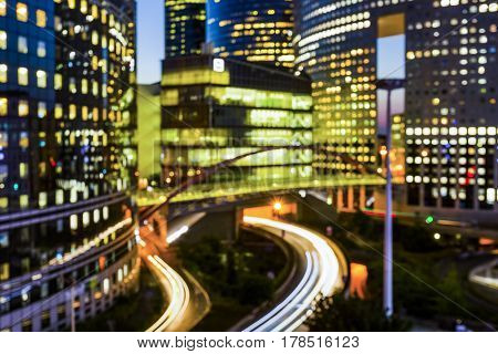Blurred Night Architecture Skyscrapers With Glass Facade. Modern Buildings In Paris Business Distric