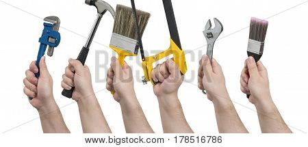 Hands Holding Various Construction Tools