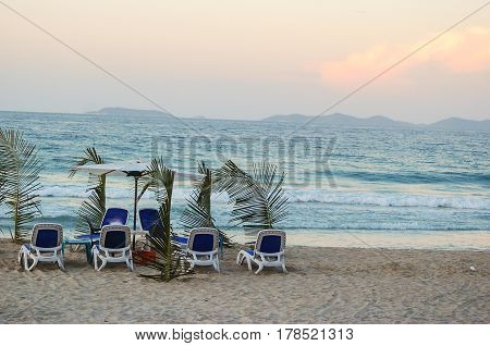 Empty chairs and tables after beachgoers leave late in the afternoon