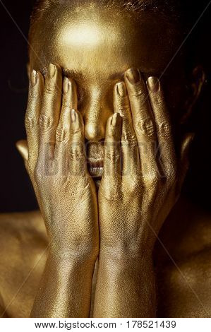 Portrait unearthly Golden girls, hands near the face. Very delicate and feminine. The eyes are closed poster