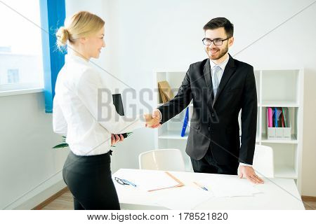 HR manager is shaking hands with a candidate after an interview